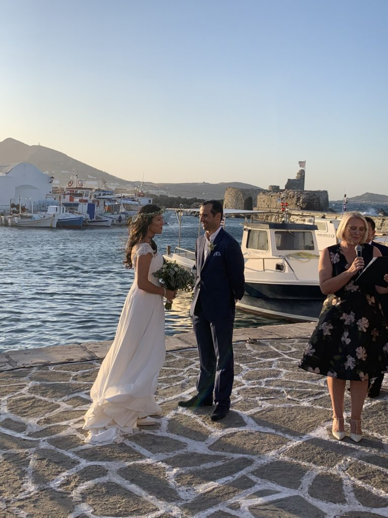 A bride and groom during their wedding ceremony in Paros, Greece with wedding celebrant ECK - a wedding celebrant in Greece