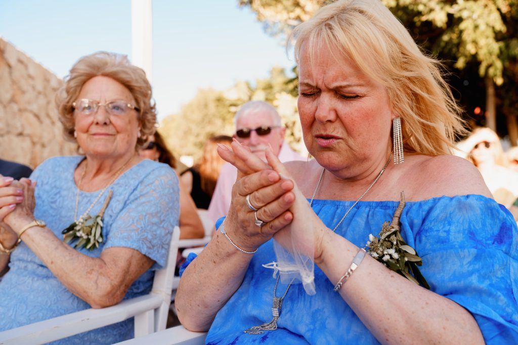 The mother of the bride in a ring warming ceremony during a wedding ceremony in Rhodes at Philosophia restaurant.