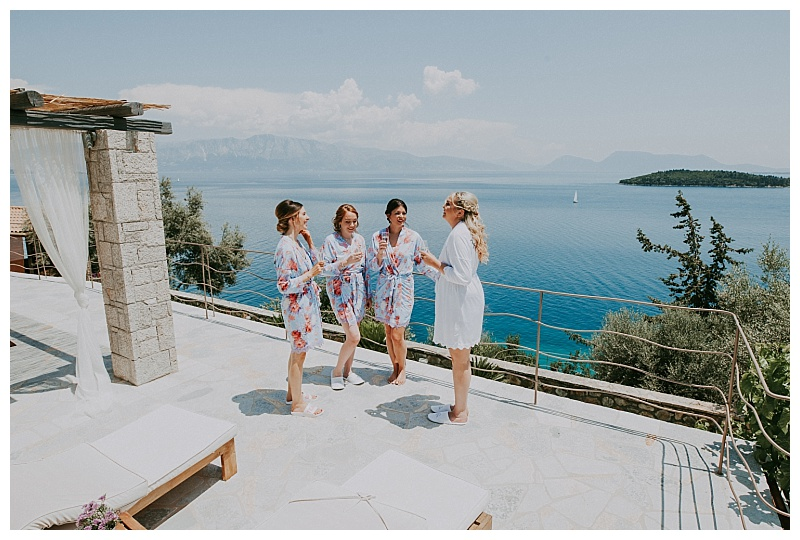 on a balcony overlooking the Ionian, a bride and her 3 bridesmaids are preaparing the a wedding in Lefkas